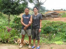 Sai Nawng and his wife near their home