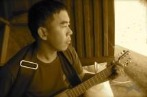 Sai Nawng plays the guitar