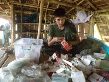 FBR Arakan Team medic checks mission supplies.
