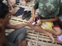 FBR team medic treats villager.