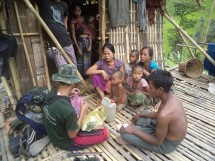 FBR team member assisting Arakanese family.