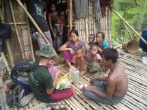 FBR team member assisting Arakanese family.