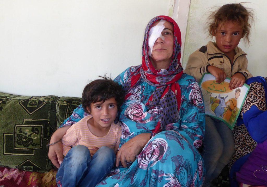 Injured woman at refugee camp in Kobane