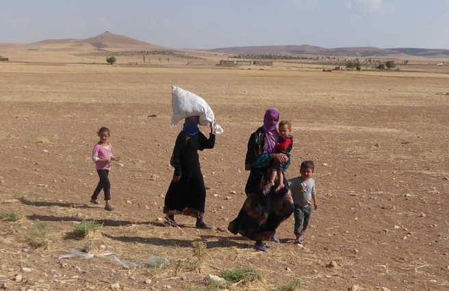 Families fleeing as ISIS is pushed back