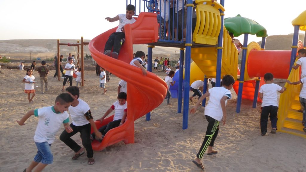 Dedicating the new playground. The children loved it!