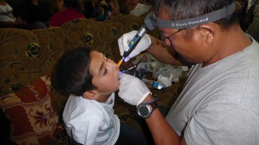 Eliya provides dental treatment to Mirky children.