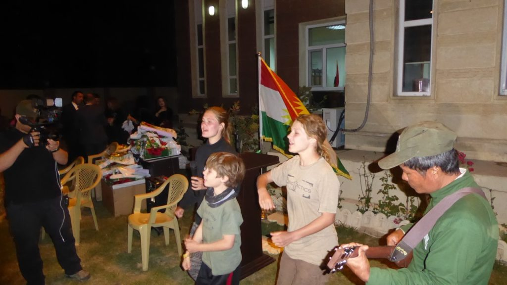"Sahale, Suuzanne and Peter sing ""Peshmerga Lead the Way"" at the program."