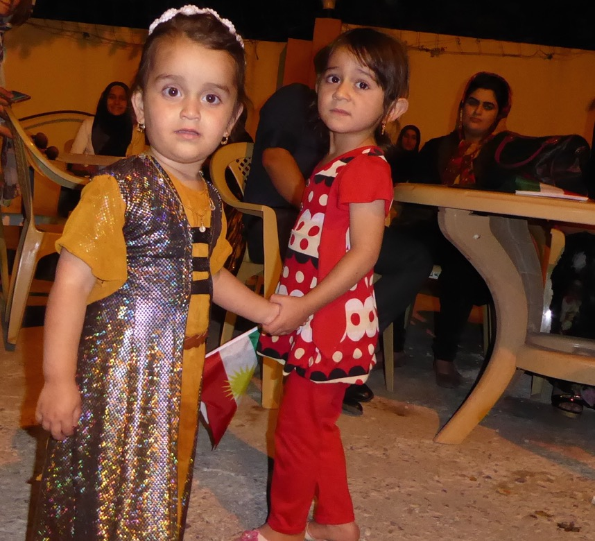 Two children who've lost their father in the fight against ISIS.