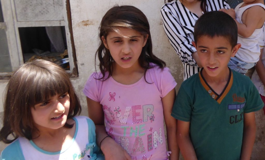 Arjin (pink shirt) with her sister and a cousin.