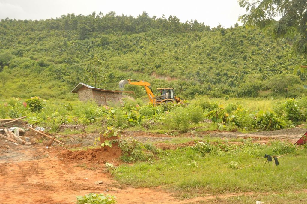 Burmese government operated backhoe loader removing structures in Bualpui village on August 31st, 2016. Falam Township, Chin state.