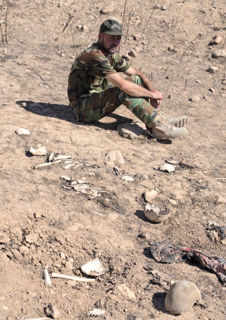 Nezar Samuel at mass grave where many of his family were killed