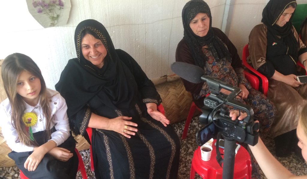 Kurd mother and daughter on the line to help
