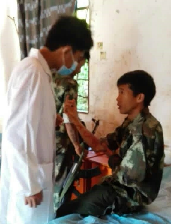 A KIA soldier receives medical attention after being wounded in a clash.