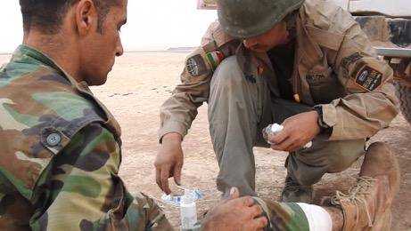 Team treating wounded Kurd Peshmerga outside Omar Qamshi Photo; FBR