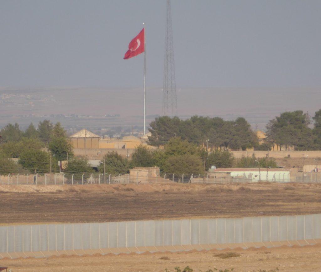 Turkish flag and new border wall outside Kobane, Syria