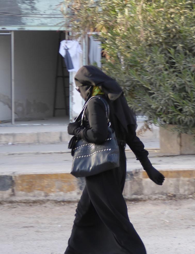 Muslim Arab Woman on the streets of Manbij