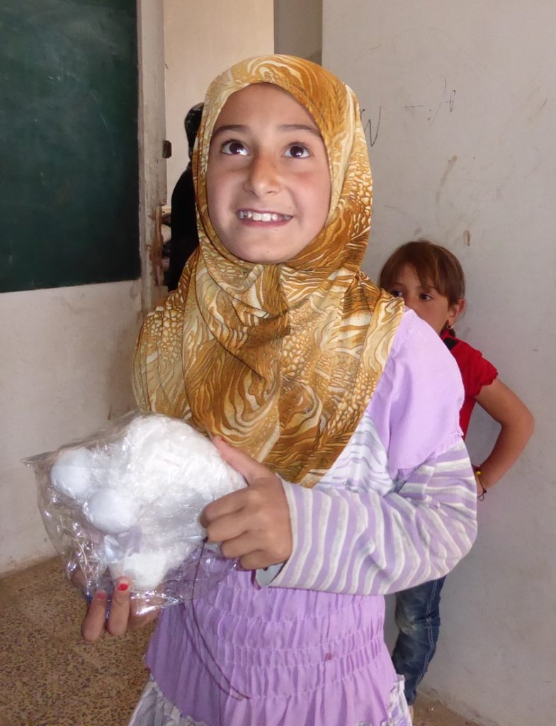 Arab girl near new front line with toy Lamb from ATP