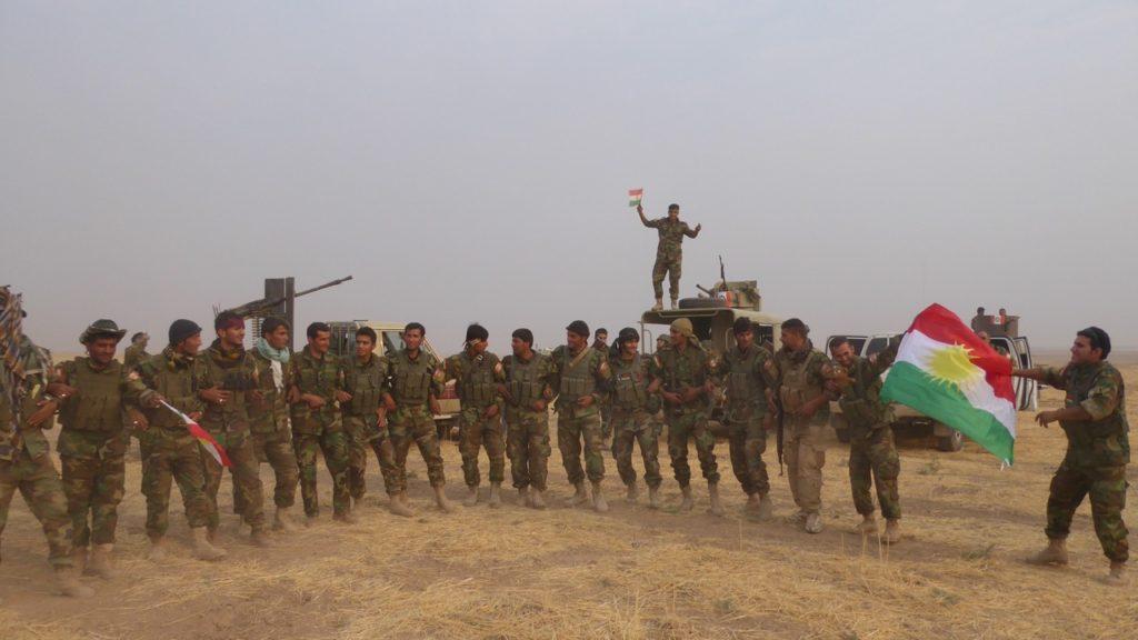 Kurdish Peshmerga celebrate after liberating Omar Qamshi Photo: FBR