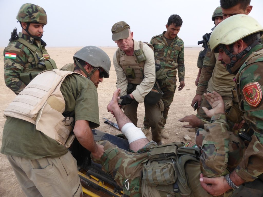 Wounded Kurd Peshmerga being treated by FBR and Kurd medical team Photo; FBR