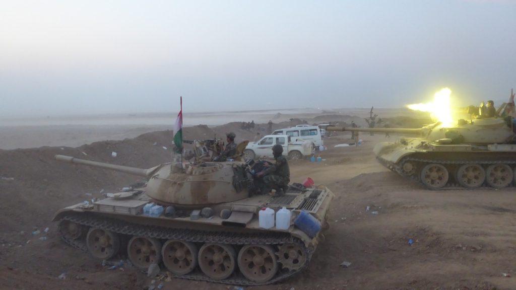 Kurd tanks return fire to ISIS as they prepare to advance on Faizalia.