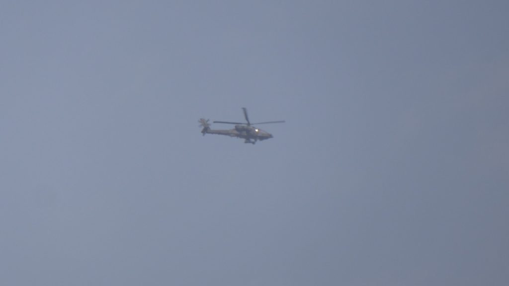 Coalition attack helicopter flies in support of the liberation.