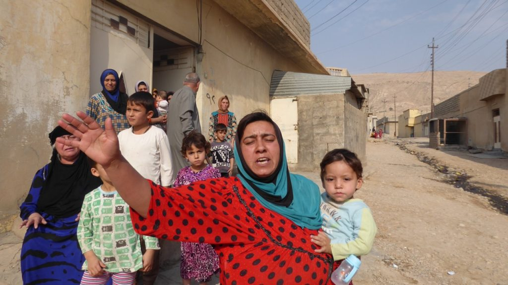 Mother telling us how bad things were under ISIS.