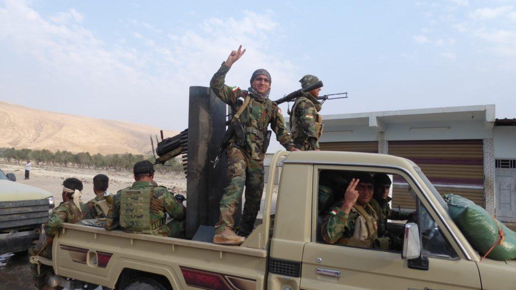 Kurdish soldiers celebrate the liberation of Faizalia.