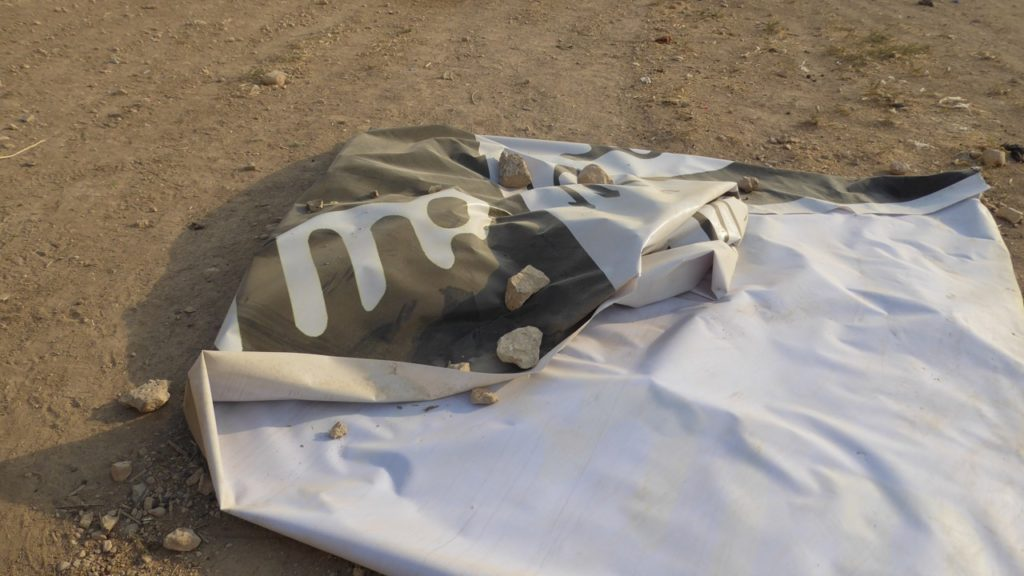ISIS flag on the ground.