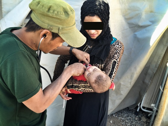 Toh, Karen medic, treats sick baby.