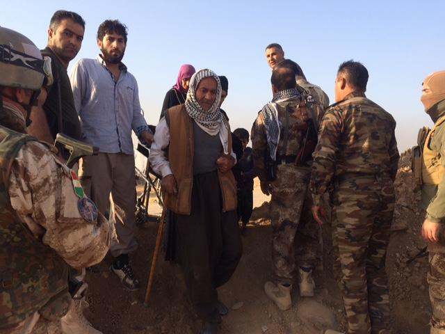 An old man walks through Peshmerga screening. Photo: FBR.