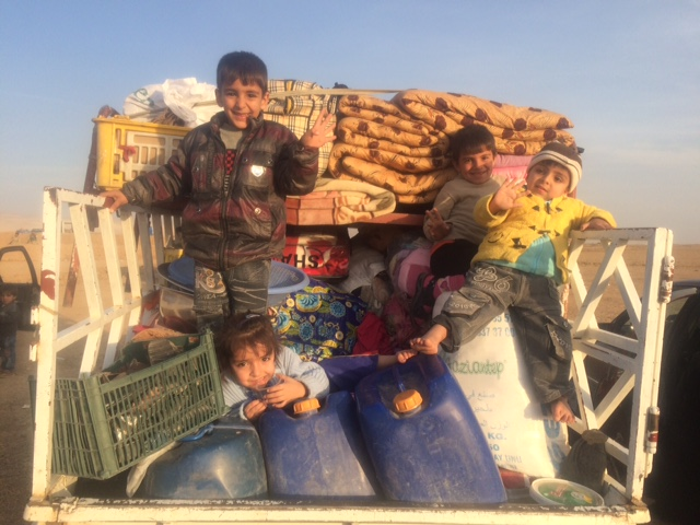 Children play among the supplies. Photo: FBR.