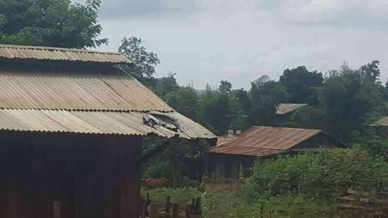 Village roof destroyed by mortar shell.