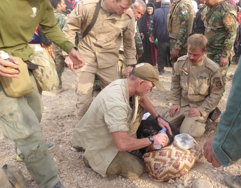 Treating a man who had collapsed in the camp. Photo: FBR.