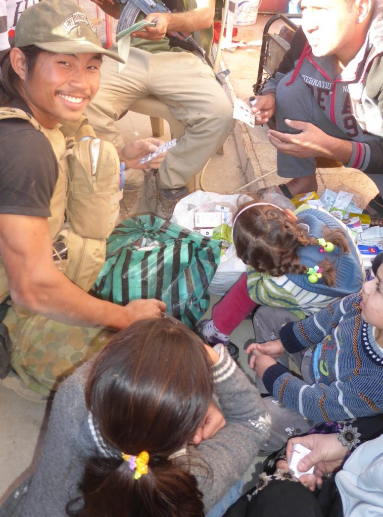 Joseph, Karen FBR medic form Burma treats families in Mosul. Photo: FBR.