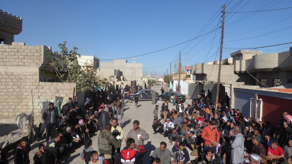 Distribution of aid outside of where ISIS attacked our position the day before. Photo: FBR.