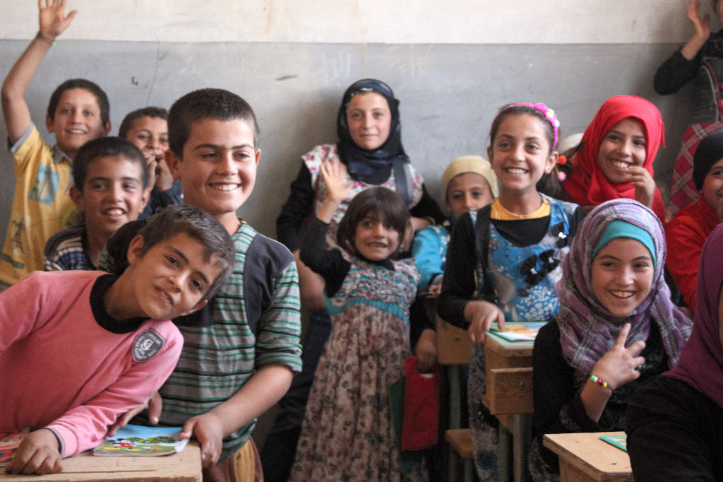 Children smile in a newly reopened school in Mambij. Photo: FBR.