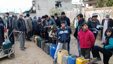 First, the kerosene is transported and offloaded at the neighborhood of Shayma. Then the family lists are collected and the families form a line with their jerry cans.