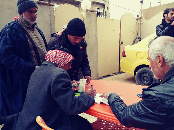 Then the families come with their family list and sign for the food they receive.