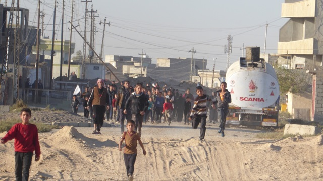 Mosul residents coming for food delivered by FBR.