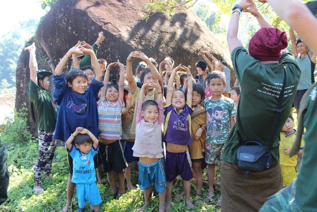 Teams sing with village children
