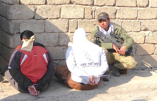 ISIS captives with Iraqi forces near Tigris River.
