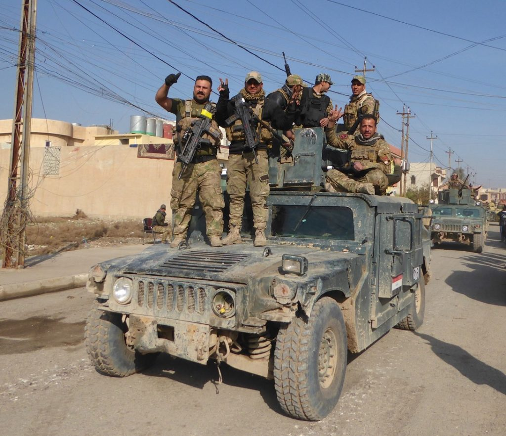 Victorious Iraqi forces in liberated eastern Mosul.