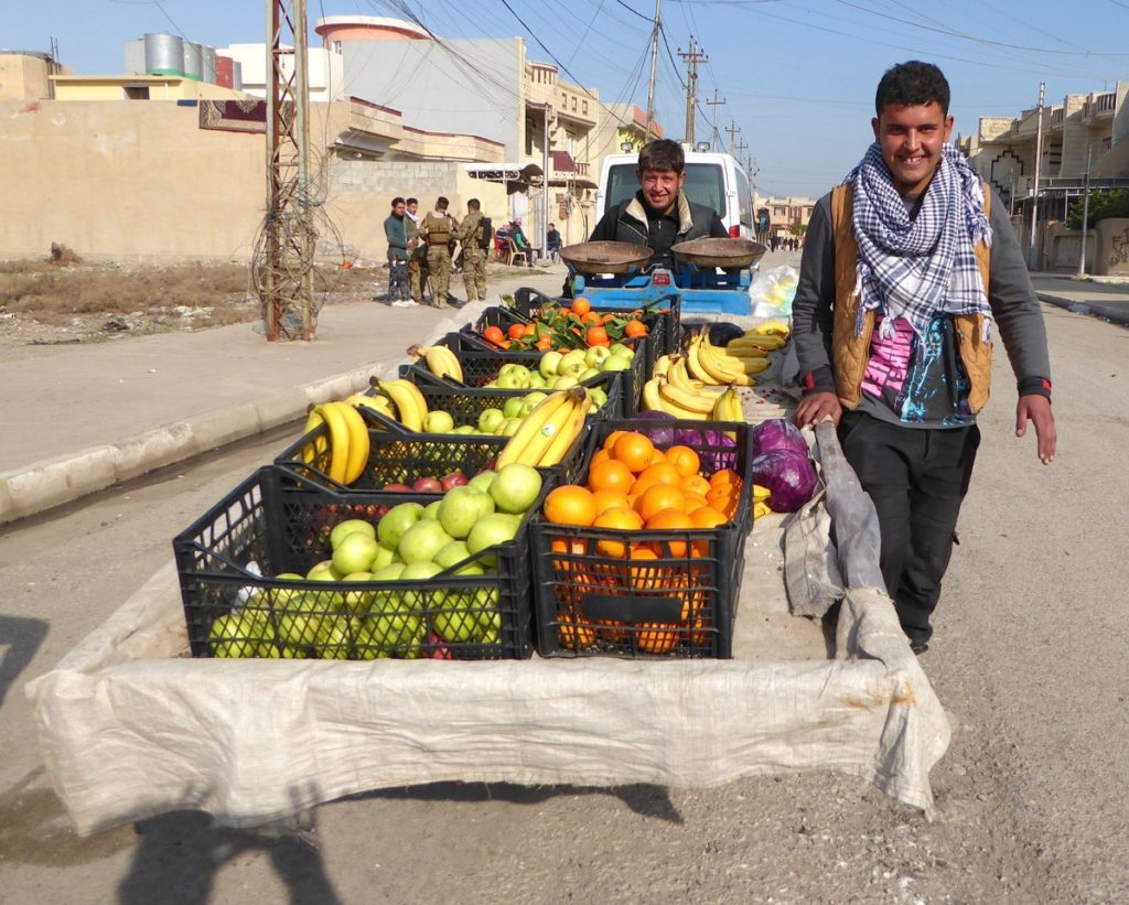 Happy fruit vendor in liberated eastern Mosul.