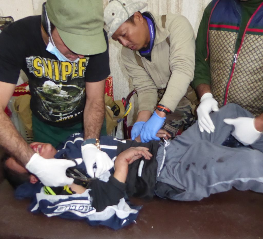 Eliya treats civilian wounded by ISIS mortar.