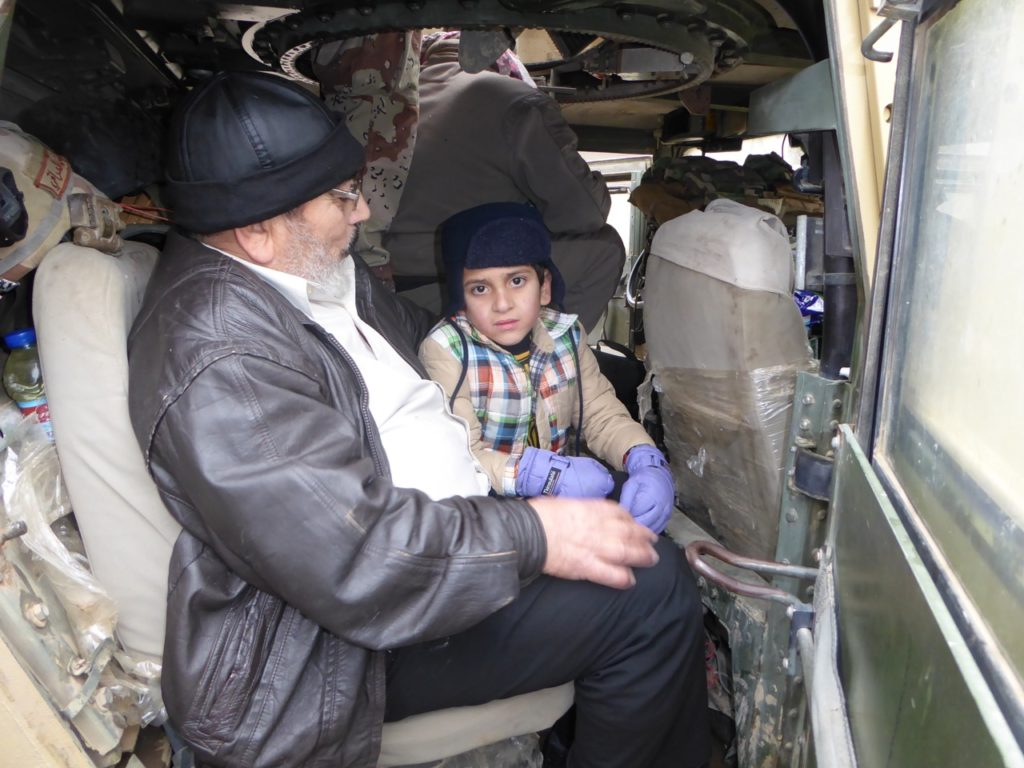 Rescued, Ayman Amin in Iraqi Humvee with man who purchased him. Photo: FBR.