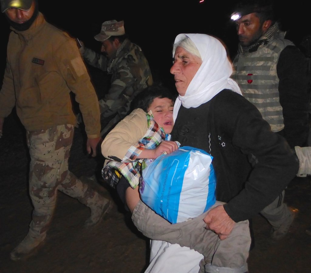 Ayman and his grandmother when they reunited on the Kurdish border. Photo: FBR.