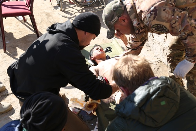 Treating a young patient hit by mortar shrapnel