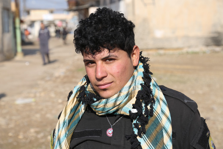 19 year old Hashi Shabi soldier with Arabic 'Nuun' pendant, which refers to Ninavah people - Christians