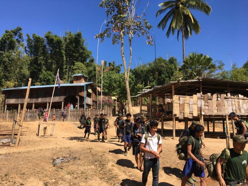Rangers on the trail through jungle villages