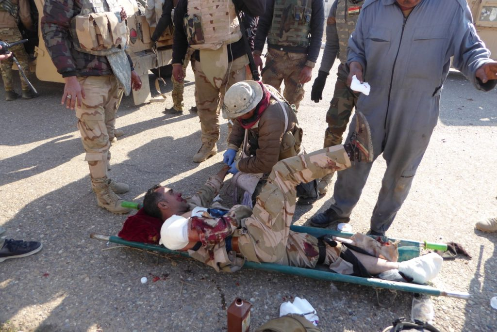 Eliya treats Iraqi solder wounded by ISIS trip wire explosion near Tell Kyf, north of Mosul